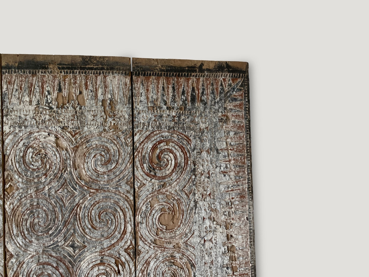 hand-carved ancient panel from Toraja, Sulawesi