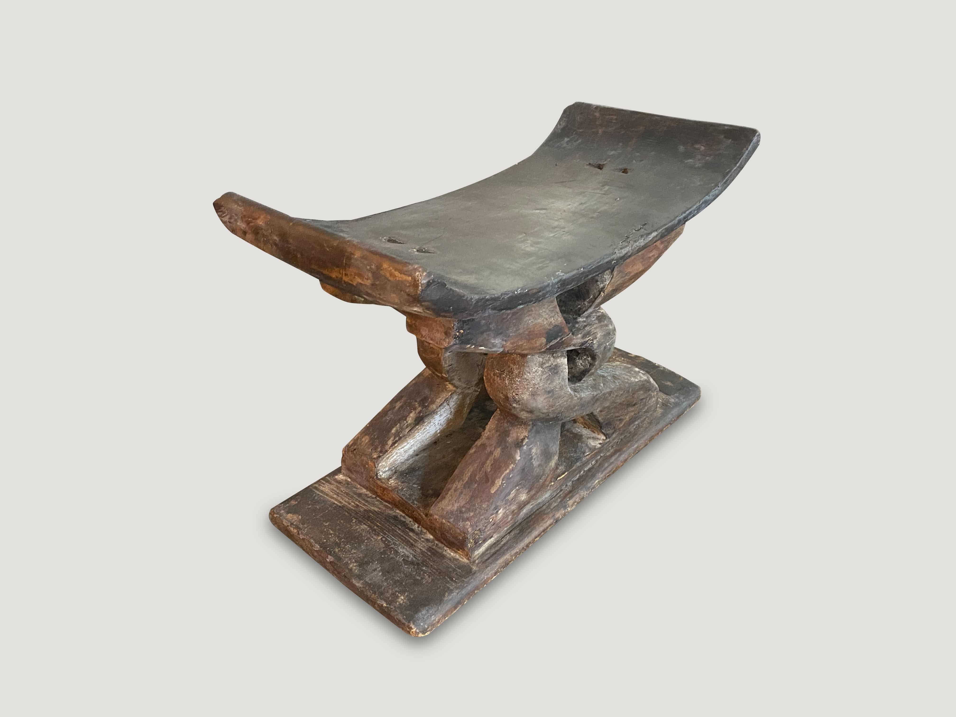 antique bench or stool made from reclaimed wood